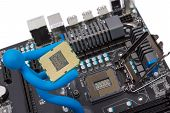 picture of processor socket  - Installation of modern processor in CPU socket on the motherboard - JPG
