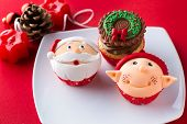 Three decorative Christmas cupcakes  on white plate