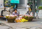 Unidentified Street Vendor Selling Vegetables In Bangkok
