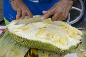 Cutting of durian (lat. Durio) on Old Phuket market