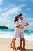young romantic couple on a beach