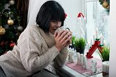brunette with mug in her hands