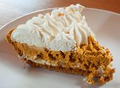 picture of pumpkin pie  - Whipped pumpkin pie that has cream on top - JPG