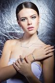 beautiful young girl with beautiful stylish expensive jewelry, necklace, earrings, bracelet, ring