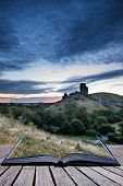 Beautiful Summer Sunrise Over Landscape Of Medieval Castle Ruins Conceptual Book Image