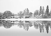 Black And White Winterr Snow Farm Landscape Reflected In Frozen Lake