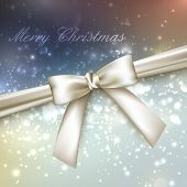 Merry Christmas. shiny multicolored holiday background with lights, sparkles, glitters, white bow an