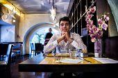 Handsome Young Man Having Lunch In Elegant Restaurant