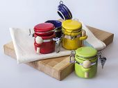 Kitchen utensils: multi-colored containers for spices
