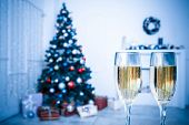Two Champagne Glass On Defocused Background Living Room With Christmas Tree. Blue Toned
