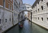 Gondolier  floating under the Bridge of Sighs