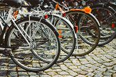 Постер, плакат: Row Of Parked Bicycles Bicycle Parking In Big City
