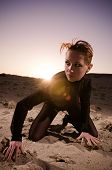 stock photo of skimpy  - Fashionable young attractive and sensuality red woman in the desert of Egypt - JPG