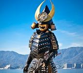 MIYAJIMA, JAPAN - OCT 19: Japanese man in samurai costume on Oct 19, 2014 in Miyajima, Japan. Samurais were the soldiers in the shogun's army and they were feared all over Japan in the Middle Ages.