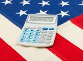 Calculator Over Usa Flag - Accounting Concept