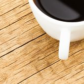 White Ceramic Coffee Cup On Old Wooden Table - View From Top