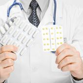 Doctor Holdling Pills In His Hands - Heath Care Concept
