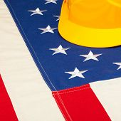 Construction Helmet Laying Over Us Flag - Closeup Shoot