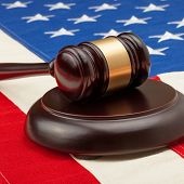 Wooden Judge Gavel And Soundboard Laying Over Usa Flag - Studio Shoot