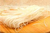 Raw Rice Noodles On Cutting Board