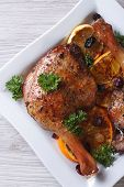 Roasted Duck Legs With Fruit And Raisins Top View Vertical