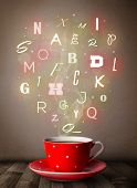Coffee cup with colorful letters, close up