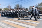 Company of police officers march on parade