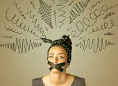 Young woman with taped mouth and curly lines around her head