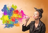 picture of graffiti  - Cute girl blowing bubble spalsh graffiti into wall - JPG