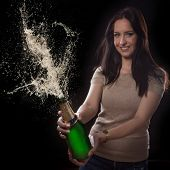 Young brunette woman with champagne glass, celebration theme.