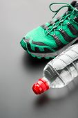Sport shoe and a bottle of water