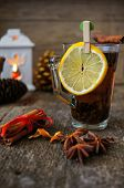 picture of christmas spices  - Christmas time cup of tea with cinnamon and anise spices festive decoration and candles - JPG
