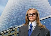 Little girl near office in funny spectacles