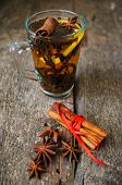 image of christmas spices  - Christmas time cup of tea with cinnamon and anise spices festive decoration and candles  - JPG