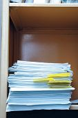 pic of stelles  - Stell office bookcase with stack of paper - JPG