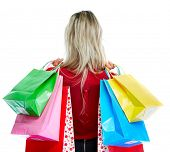 Beautiful young blond woman with shopping bags