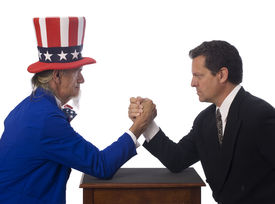 stock photo of lobbyist  - Uncle Sam arm wrestling with a businessman on a white background - JPG