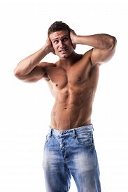stock photo of irritated  - Irritated frustrated stressed shirtless muscular young man covering his ears too much noise - JPG