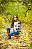 foto of west highland white terrier  - woman with west highland terrier in the park - JPG