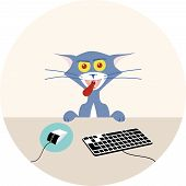 stock photo of lunate  - Angry cat sitting in front of computer - JPG