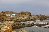 stock photo of caravan  - Caravan camping near a rocky seaside shore - JPG