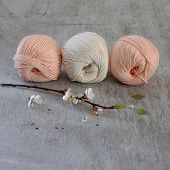 picture of hook  - Ball of cream yarn with crochet hook or needle sticking through - JPG