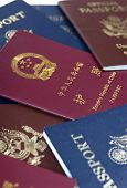stock photo of passport template  - different types of passports from china and the usa - JPG