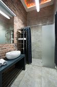 foto of guest-house  - Interior of contemporary bathroom with brick wall - JPG