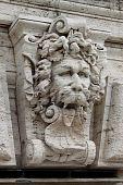 Satyr mask basrelief