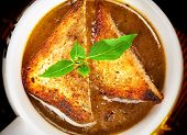 image of onion  - Famous onion soup with onions and olive oil in the background close up - JPG