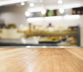 pic of wooden table  - Table top with blurred kitchen interior background - JPG
