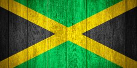 picture of jamaican flag  - Jamaica flag or Jamaican banner on wooden boards background - JPG