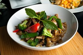 stock photo of noodles  - Pad kee mao drunken noodle thai dish with beef and mixed vegetables - JPG