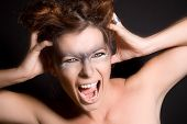 picture of wolverine  - Woman with wolf eyes grasping her head and screaming - JPG